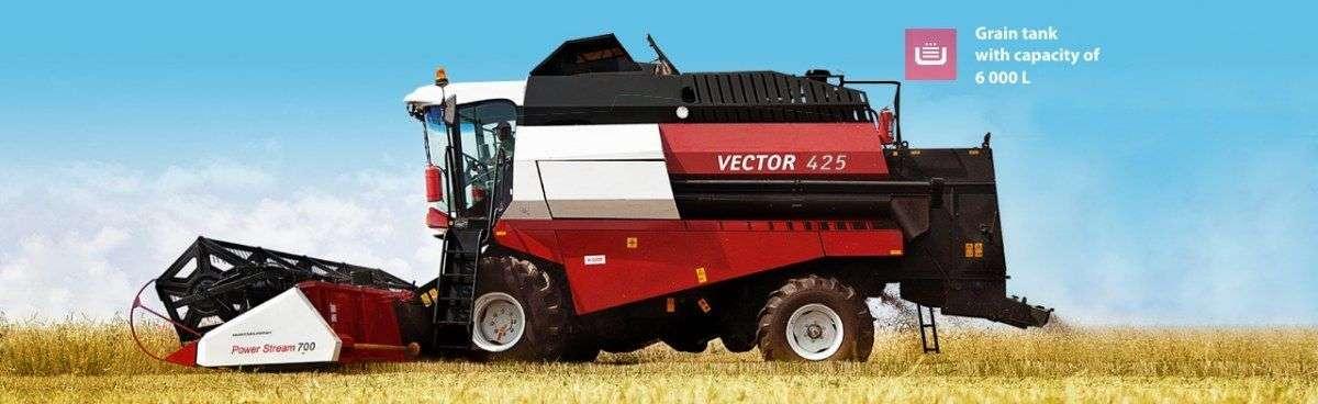 Rostselmash Vector 425 na polu podczas pracy zbiornik na ziarno o pojemności 6000l